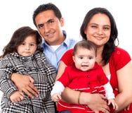 Família nova feliz bonita Fotografia de Stock