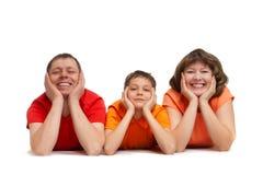 Família que coloca no assoalho imagens de stock royalty free