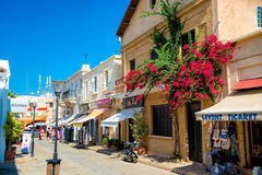 FAMAGUSTA, CYPRUS - OCTOBER 10, 2015: People walk through a narrow street in the old town of Famagusta.  royalty free stock photos