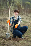 Famale farmer  planting  sprouts Stock Image
