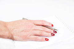 Famale hand with pen writting in notebook Royalty Free Stock Photography