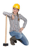 Famale laborer kneeling Royalty Free Stock Images