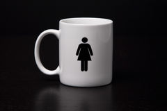 Famale Mug. A mug with a female on it isolated on a black background Royalty Free Stock Photography