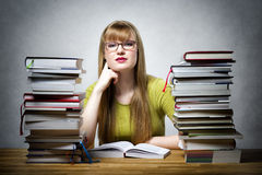 Famale Student with many books Royalty Free Stock Photo