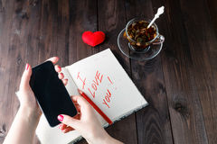 Famale write love sms Stock Photography