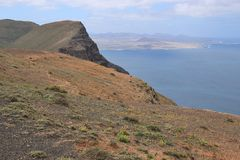 Famara cliffs and ocean. North Lanzarote, Canary Islands, Spain. Royalty Free Stock Photo