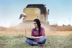 Famer girl with laptop in the field Royalty Free Stock Photo