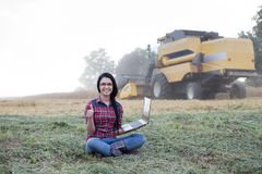 Famer girl with laptop in the field Royalty Free Stock Photography