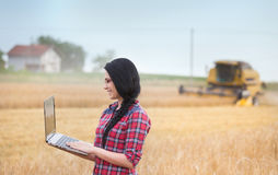 Famer girl with laptop in the field Stock Photos