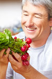Famer selling radish in farm shop Stock Image