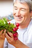 Famer selling radish in farm shop Stock Image