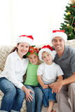 Famiglia adorabile a natale Fotografia Stock