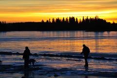 Famiglia al tramonto Fotografie Stock Libere da Diritti