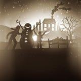 Famiglia che fa un pupazzo di neve - Buon Natale Fotografie Stock