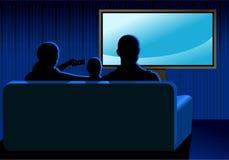 Famiglia che guarda TV Fotografie Stock
