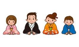 Famiglia che porta un kimono Immagine Stock