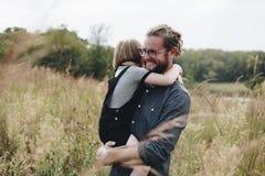 Famiglia che spende tempo in azienda agricola Fotografia Stock