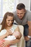 Famiglia con il bambino appena nato Fotografia Stock Libera da Diritti