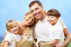 Famiglia con l'animale domestico Immagine Stock Libera da Diritti