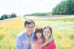 Famiglia con paesaggio in Furano Fotografie Stock Libere da Diritti