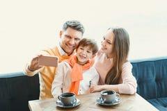 Famiglia con un bambino Fotografia Stock
