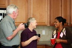 Famiglia in cucina fotografia stock