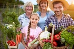 Famiglia degli agricoltori, tre generazioni Immagine Stock