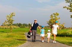 Famiglia dei giocatori di golf Fotografie Stock