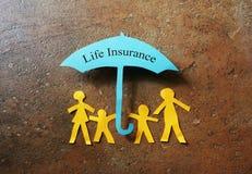 Famiglia della carta di assicurazione sulla vita Fotografia Stock
