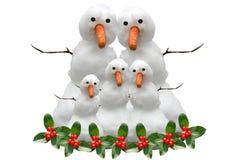 Famiglia della neve di natale fotografie stock libere da diritti