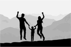 Famiglia della siluetta delle montagne Immagine Stock