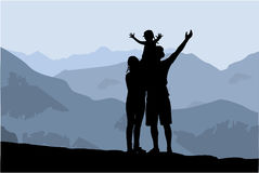 Famiglia della siluetta delle montagne immagini stock