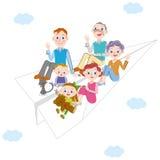 Famiglia della tre-generazione e dell'aeroplano di carta Immagine Stock