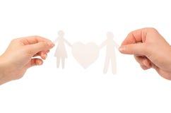 Famiglia di carta in mani Fotografie Stock