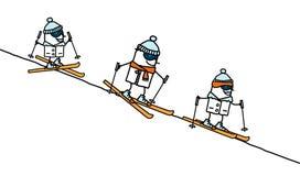 Famiglia di corsa con gli sci Immagine Stock