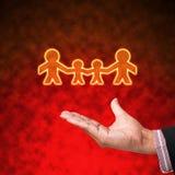 Famiglia di indicatore luminoso con la mano Immagini Stock