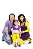 Famiglia di per tre persone su bianco Immagine Stock