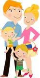 Famiglia felice che gesturing con il sorriso allegro Fotografia Stock