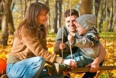 Famiglia felice che si distende all'aperto Immagine Stock Libera da Diritti