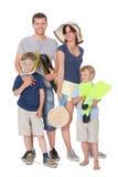 Famiglia felice con i bambini su una priorità bassa bianca Immagine Stock