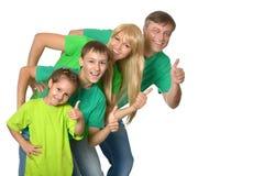 Famiglia felice con i pollici in su Immagine Stock