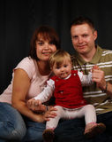 Famiglia felice con il bambino adorabile Fotografia Stock Libera da Diritti
