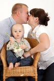 Famiglia felice con un bambino. Fotografie Stock