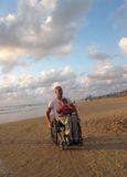 Famiglia felice della sedia a rotelle Immagine Stock Libera da Diritti