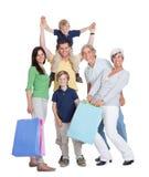Famiglia felice delle generazioni con i sacchetti di acquisto Fotografie Stock Libere da Diritti