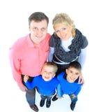 Famiglia isolata su bianco Fotografie Stock