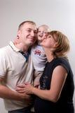 Famiglia negli abbracci Immagini Stock