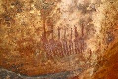 Famiglia nell'immagine grafica della roccia del boscimano preistorico Fotografia Stock Libera da Diritti