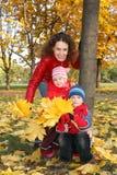 Famiglia nella sosta Fotografia Stock