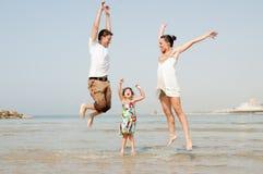 Famiglia nella spiaggia Fotografia Stock
